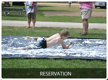 child sliding in suds photo with reservation link